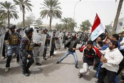 Riot policemen disperse protesters during Basra demonstration