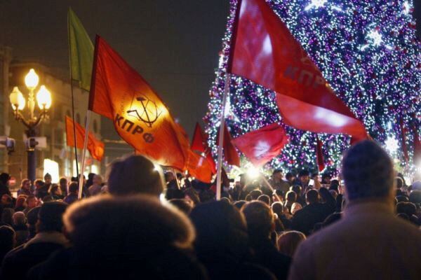 Russian Communist Party supporters hold many-coloured flags