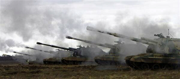 Russian Msta-S self-propelled howitzers fire during war drills in Volgograd
