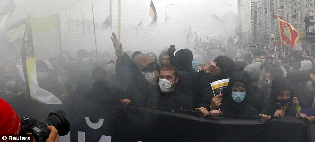Russian nationalist protestors march in a Moscow suburb