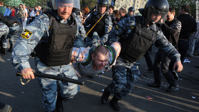 Russian police detain a protester during a rally in Moscow