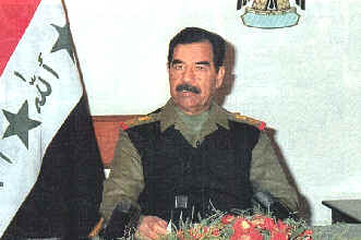 Saddam Hussein confers with his deputies
