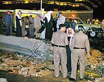 Saudi police officers examine the scene of an explosion in Riyadh, Wednesday