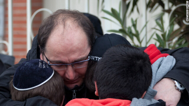 School children are comforted at the scene of the fatal shooting in Toulouse, France on Monday, March 19. A gunman opened fire on the Ozar Hatorah Jewish school, killing four people -- including a teacher and three children.