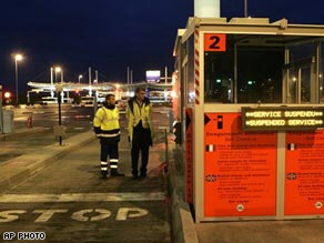 Security guards at Eurotunnel check-in booth in Calais