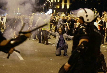 Members of the Serbian Radical Party clash with riot police in Belgrade