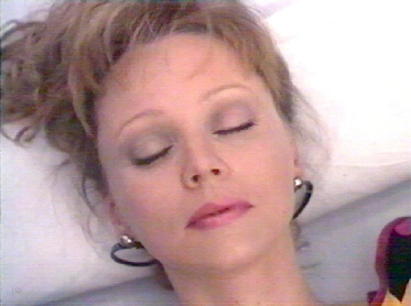 Shelley Long lies dead after choking on food in the comedy Hello Again