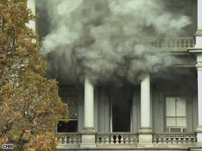 Smoke billows from a window in the White House