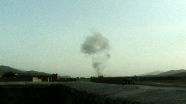 Smoke from a Taliban truck bombing targeting an American base in Afghanistan - September 11, 2011