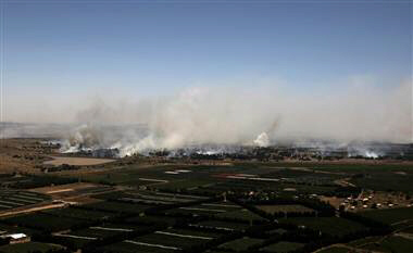 Smoke from shelling rises on Syrian side of border with Israel