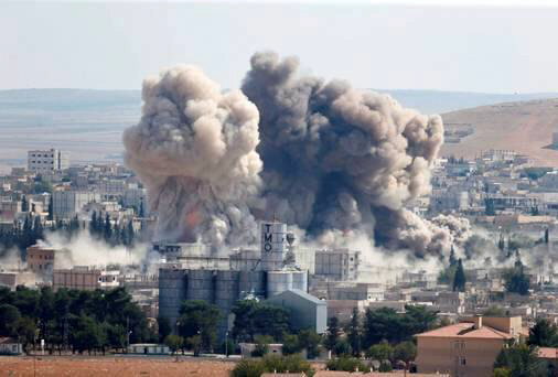 Smoke rises after an U.S.-led air strike in the Syrian town of Kobani