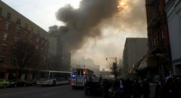 Smoke rises from site of explosion and building collapse at Park Ave