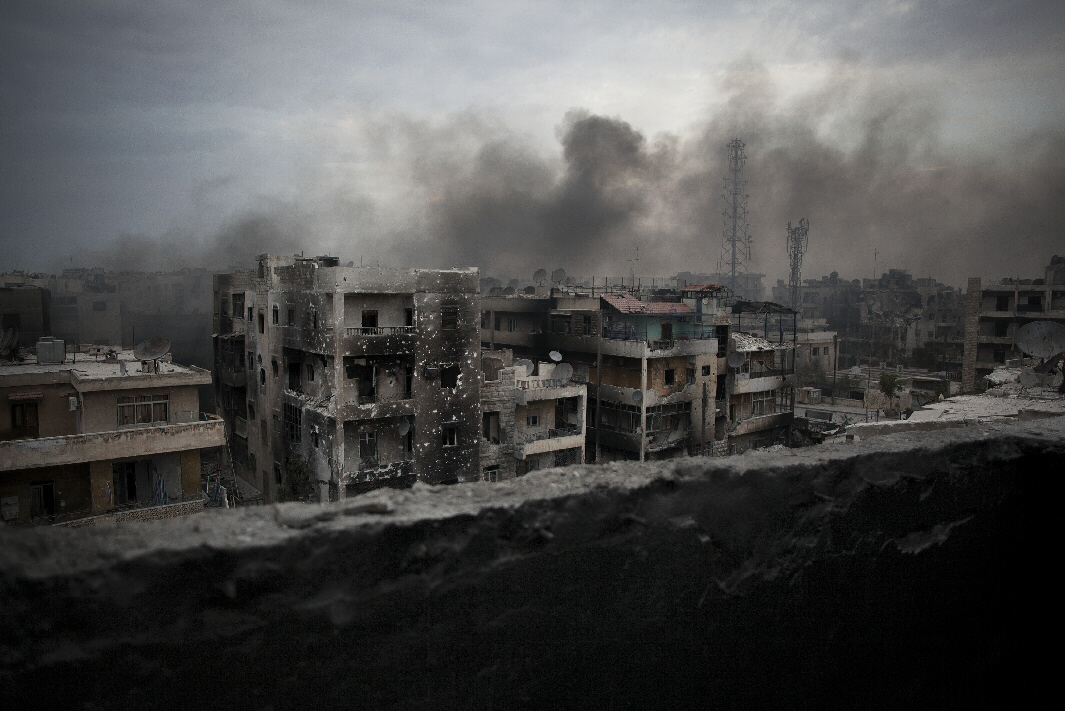 Smoke rises over Saif Al Dawla district in Aleppo, Syria