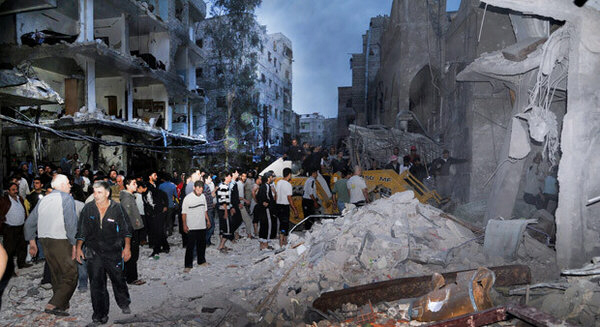 Syrian citizens inspect damaged buildings at site where bomb exploded