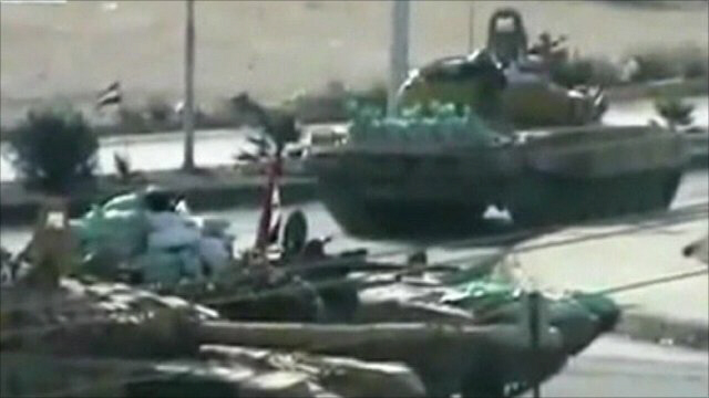 Syrian tanks in action near Turkish border