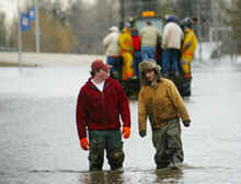 Teenagers wade through floodwater in Minto, North Dakota