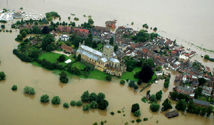 Tewkesbury Cathedral and surrounding homes stand isolated by the flood water.