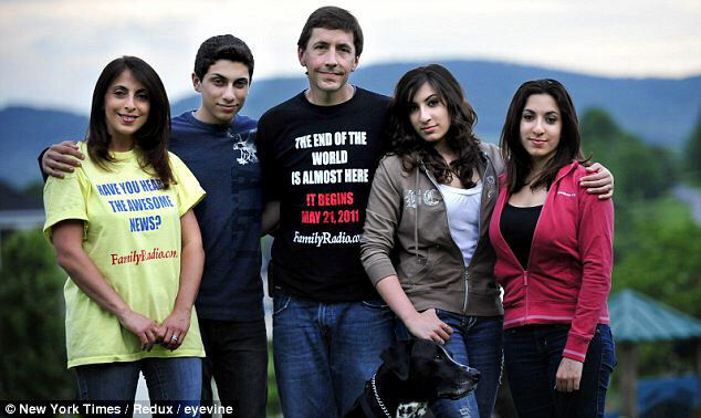 Doomed: The Haddad family (L-R Abby Haddad Carson, Joseph Carson-Haddad, Robert Carson, Faith and Grace Haddad and dog Hunter) are expecting the world to end on Saturday, but say their children won't go to heaven