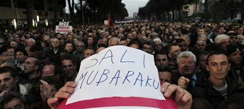Thousands of opposition protesters participate in an anti-government rally Friday in Tirana to demand the resignation of Prime Minister Sali Berisha over corruption allegations.