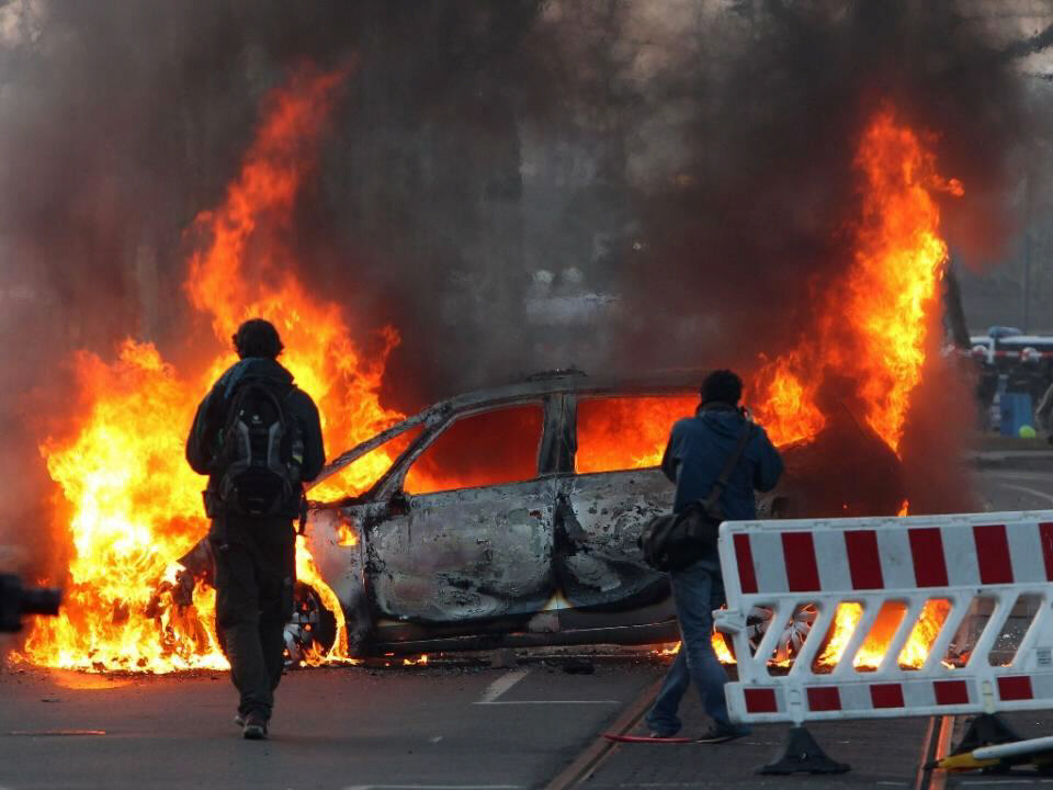 Torched cars at massive anti-austerity rally in Frankfurt, Germany