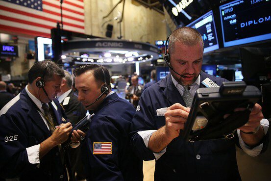 Traders on the New York Stock Exchange floor Friday