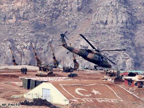 Turkish army Super Cobra helicopter takes off with artillery units