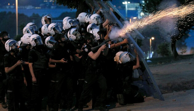 Turkish riot police fire tear gas canisters