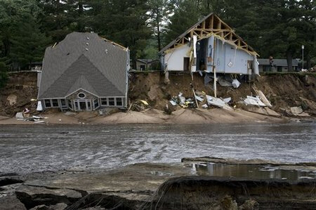 Two houses fall into an emptied Lake Delton
