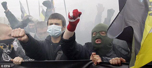 Two masked Russian protesters show their anger and resentment