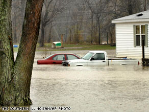 Two vehicles sit submerged in floodwaters in Illinois