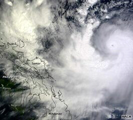 Typhoon Parma slams into flood-plagued Philippines