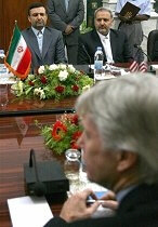U.S. Ambassador to Iraq Ryan Crocker, right, and his Iranian counterpart Hassan Kazemi Qomi, left