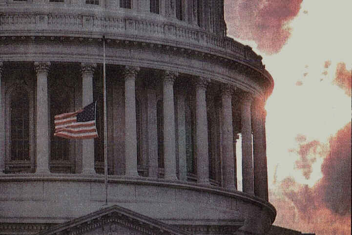 US flag at half mast next to Capitol Building