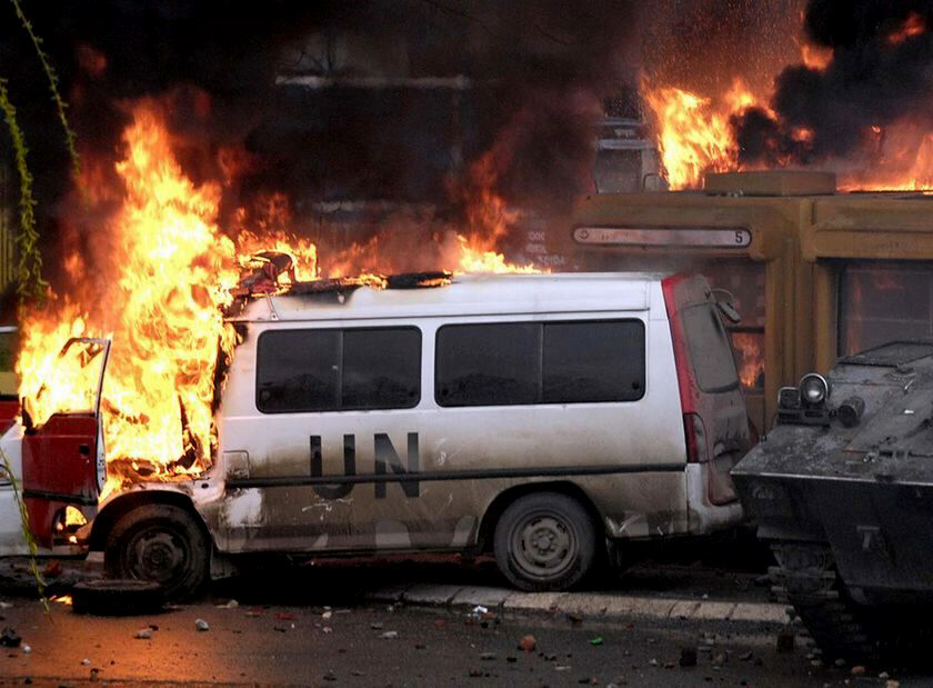 Unrest: A UN car burns after Kosovo Serbs clashed with KFOR soldiers in Mitrovica (AFP: Dimitar Dilkoff)