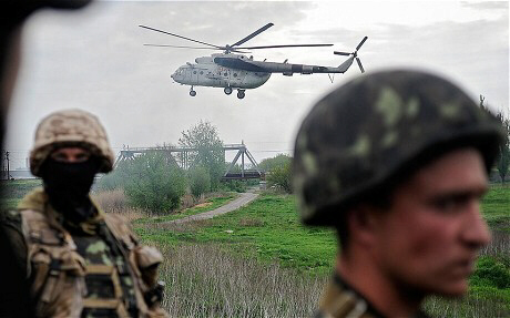 Ukrainian soldiers and a helicopter near Slavyansk (EPA)