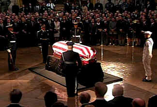 The president lies in state under the 'shroud' of the American flag