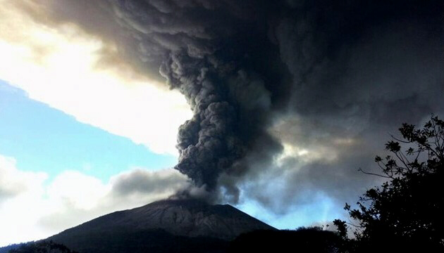 View of the Chaparrastique volcano spewing ashes and smoke in southern El Salvador on December 29.