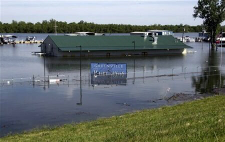 The rising waters of Lake Ferguson flood the Greenville Yacht Club and are forcing the evacuation of  Lighthouse Point.