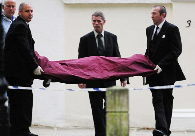 Winehouse's body is seen being removed from her home