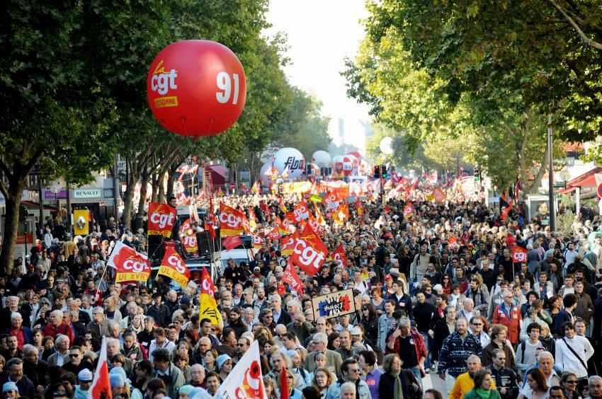 Workers in the French capital march through the city to show their displeasure over Sarkozy's pension-reducing austerity measure.