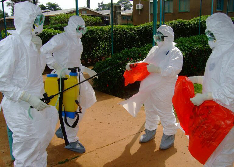 World Health Organization officals wear protective clothing