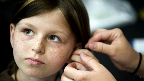 Zahra Clare Baker, 10, gets a hearing aid