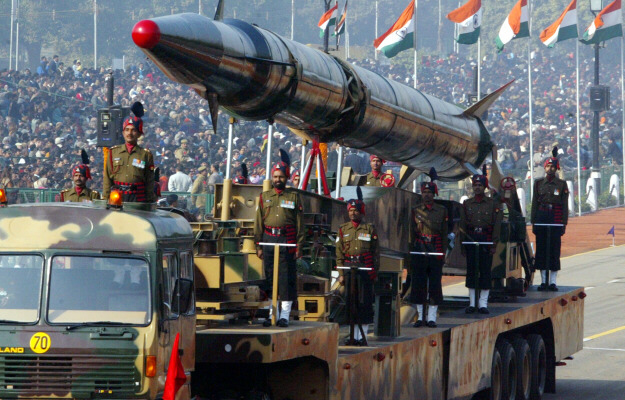 Indian Army personnel display an Agni-II missile